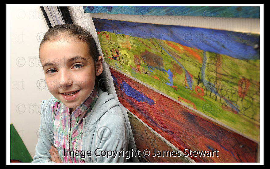 22/06/2009  Copyright  Pic : James Stewart.28_cross_currents.DELTA STUDIOS :: CROSS CURRENTS EXHIBITION :: KERYN HOWISON (8), FROM WALLACESTONE PRIMARY , WITH ONE OF HER PAINTINGS :: .James Stewart Photography 19 Carronlea Drive, Falkirk. FK2 8DN      Vat Reg No. 607 6932 25.Telephone      : +44 (0)1324 570291 .Mobile              : +44 (0)7721 416997.E-mail  :  jim@jspa.co.uk.If you require further information then contact Jim Stewart on any of the numbers above.........