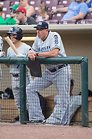 West Michigan Whitecaps hitting coach Mike Hessman (27) watches the action from the dugout during the game against the Dayton Dragons at Fifth Third Field on May 29, 2017 in Dayton, Ohio.  The Dragons defeated the Whitecaps 4-2.  (Brian Westerholt/Four Seam Images)