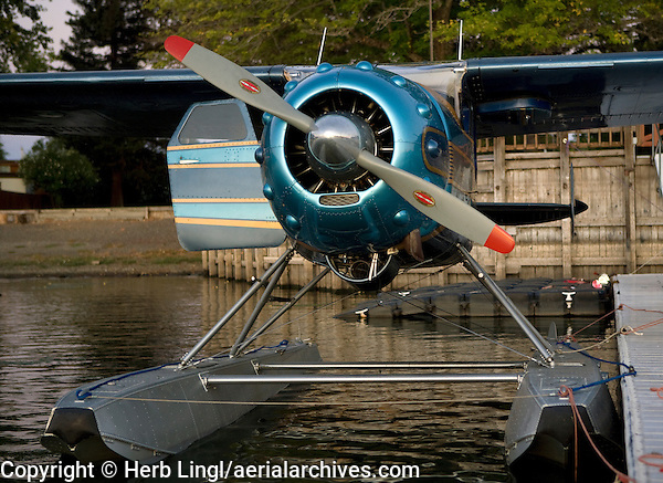 Cessna 195, N3877V, on floats docked at the Skylark Shores Resort dock, Clear Lake Seaplane Splash In, Lakeport, California, Lake County, California