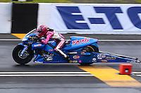 May 31, 2014; Englishtown, NJ, USA; NHRA pro stock motorcycle rider Angie Smith during qualifying for the Summernationals at Raceway Park. Mandatory Credit: Mark J. Rebilas-
