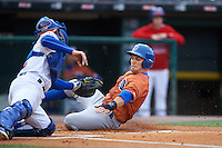 Durham Bulls center fielder Johnny Field (1) slides home as catcher A.J. Jimenez attempts the tag during a game against the Buffalo Bisons on June 13, 2016 at Coca-Cola Field in Buffalo, New York.  Durham defeated Buffalo 5-0.  (Mike Janes/Four Seam Images)