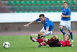 St Johnstone v FC Minsk...01.08.13 Europa League Qualifier at Neman Stadium, Grodno, Belarus...<br /> Mikita Bukatkin was booked for this challenge on Steven MacLean<br /> Picture by Graeme Hart.<br /> Copyright Perthshire Picture Agency<br /> Tel: 01738 623350  Mobile: 07990 594431