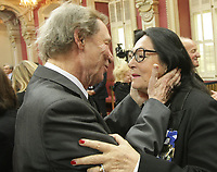 Singers Jean-Pierre Ferland and Nana Mouskouri hug after a ceremony where she received the Ordre National du Quebec Tuesday May 28, 2013 at the legislature in Quebec City.