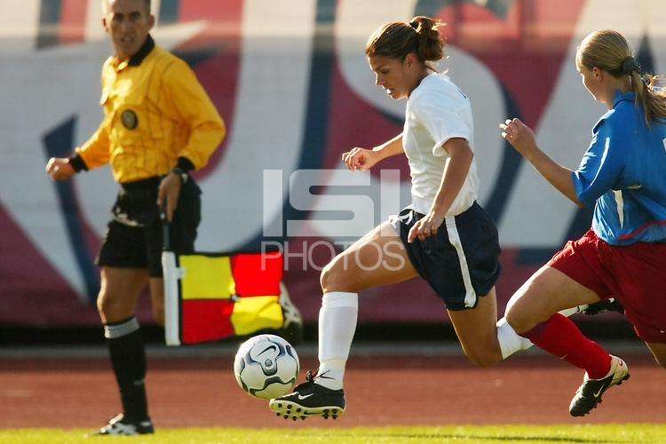 Mia Hamm is chased by Vera Stroukova of Russia. The USWNT defeated Russia 5-1 on  September 29, at Mitchel Athletic Complex, Uniondale, NY.
