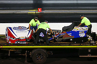 Sep 3, 2016; Clermont, IN, USA; The remains of the carbon fiber body from the car of NHRA funny car driver Robert Hight after an engine explosion alongside Dave Richards during qualifying for the US Nationals at Lucas Oil Raceway. Hight was uninjured in the explosion. Mandatory Credit: Mark J. Rebilas-USA TODAY Sports