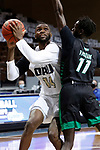 SIOUX FALLS, SD - MARCH 7: DeShang Weaver #14 of the Oral Roberts Golden Eagles eyes the basket past Bentiu Panoam #11 of the North Dakota Fighting Hawks during the Summit League Basketball Tournament at the Sanford Pentagon in Sioux Falls, SD. (Photo by Richard Carlson/Inertia)