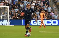 KANSAS CITY, KS - AUGUST 10: Roberto Puncec #4 of Sporting Kansas City dribbles the ball upfield during a game between Club Leon FC and Sporting KC at Children's Mercy Park on August 10, 2021 in Kansas City, Kansas.