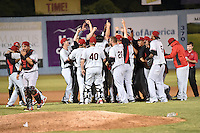 Hickory Crawdads celebration after game 3 of the South Atlantic League Championship Series between the Asheville Tourists and the Hickory Crawdads on September 17, 2015 in Asheville, North Carolina. The Crawdads defeated the Tourists 5-1 to win the championship. (Tony Farlow/Four Seam Images)