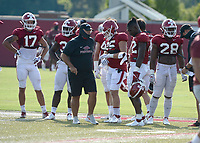 Arkansas linebackers J.T. Towers (from left), Kelin Burrle, Jake Yurachek, Deon Edwards and Andrew Parker gather before moving to another position on the field Tuesday, Sept. 8, 2020, during practice at the university football practice fields in Fayetteville. Visit nwaonline.com/200909Daily/ for today's photo gallery.<br /> (NWA Democrat-Gazette/Andy Shupe)