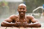 Man in swimming pool, smiling, portrait