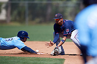 Minnesota Twins shortstop Royce Lewis (8) catches a pickoff attempt throw as Carl Chester (88) dives back into second base during a Minor League Spring Training game against the Tampa Bay Rays on March 17, 2018 at CenturyLink Sports Complex in Fort Myers, Florida.  (Mike Janes/Four Seam Images)