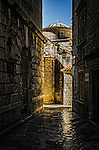 A cobblestone alleyway in the medieval  walled town of Kotor in Montenegro.