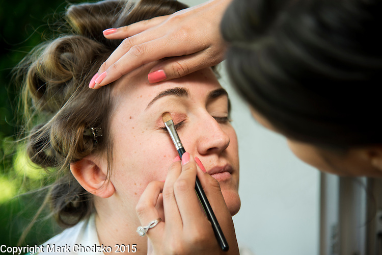 Lauren has detailed make-up applied to her eyes.