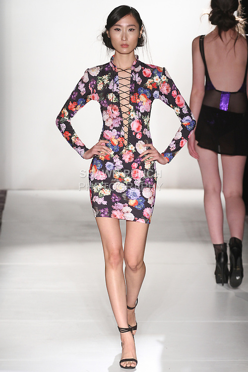 Model walks runway in an outfit from the I Am Snob Fall Winter 2015 collection by Crystian Amir, during the Emerging Designers Fall Winter 2015 fashion show for  Fashion Gallery New York Fashion Week Fall 2015.