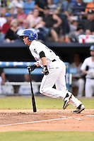 Asheville Tourists left fielder Eric Toole (9) swings at a pitch during a game against the Hagerstown Suns at McCormick Field on September 4, 2016 in Asheville, North Carolina. The Suns defeated the Tourists 10-5. (Tony Farlow/Four Seam Images)