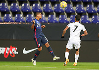 WIENER NEUSTADT, AUSTRIA - NOVEMBER 16: Reggie Cannon #20 of the United States heads a ball during a game between Panama and USMNT at Stadion Wiener Neustadt on November 16, 2020 in Wiener Neustadt, Austria.