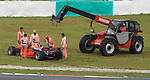 05 Apr 2009, Kuala Lumpur, Malaysia ---    Marshalls remove out the car of  Trust Team Arden driver Luiz Razia of Brazil during the race 2 of the FIA GP2 Asia Series 2009 at the Sepang circuit, near Kuala Lumpur. Photo by Victor Fraile --- Image by © Victor Fraile / The Power of Sport Images