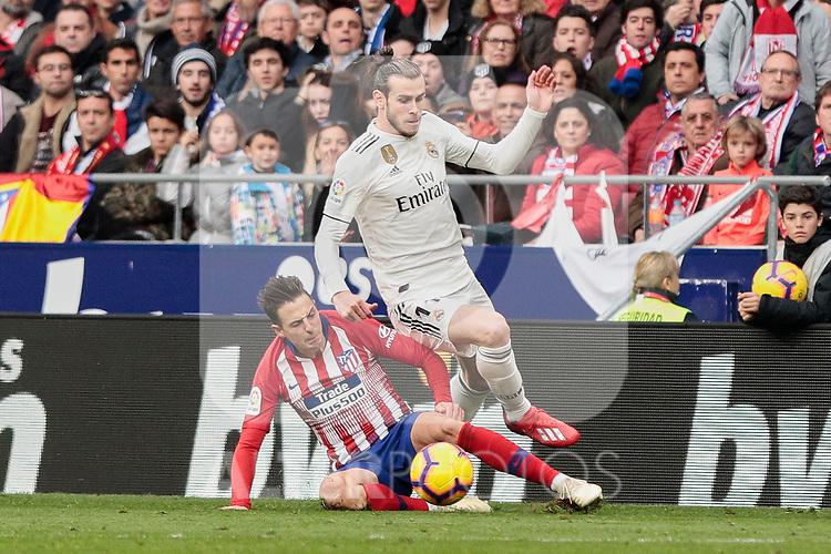 Atletico de Madrid's Santiago Arias and Real Madrid's Gareth Bale during La Liga match between Atletico de Madrid and Real Madrid at Wanda Metropolitano Stadium in Madrid, Spain. February 09, 2019. (ALTERPHOTOS/A. Perez Meca)