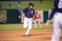 Northwest Arkansas Naturals infielder Angelo Castellano (16) rounds second for third on May 18, 2019, at Arvest Ballpark in Springdale, Arkansas. (Jason Ivester/Four Seam Images)