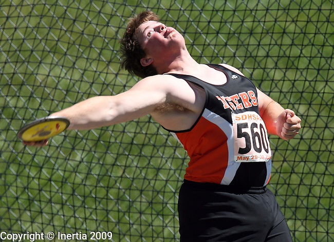 SPEARFISH, SD - May 29: Sam Sauer of Mobridge throws the discus Friday at the Class A State Track Meet in Spearfish. (Photo by Dave Eggen/Inertia)