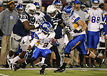 San Jose State's Tim Crawley runs into a crowd during an NCAA college football game against Nevada, in Reno, Nev., on Saturday, Nov. 16, 2013. (AP Photo/Cathleen Allison)
