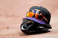 A Louisville Bats cap and sunglasses sit on top of a glove at Knights Stadium during the International League game between the Louisville Bats and the Charlotte Knights on July 17, 2011 in Fort Mill, South Carolina.  The Knights defeated the Bats 7-6.   (Brian Westerholt / Four Seam Images)
