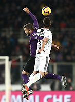 Calcio, Serie A: Fiorentina - Juventus, stadio Artemio Franchi Firenze 1 dicembre 2018.<br /> Juventus' Mario Mandzukic (r) in action with Fiorentina's captain German Pezzella (l) during the Italian Serie A football match between Fiorentina and Juventus at Florence's Artemio Franchi stadium, December 1, 2018.<br /> UPDATE IMAGES PRESS/Isabella Bonotto