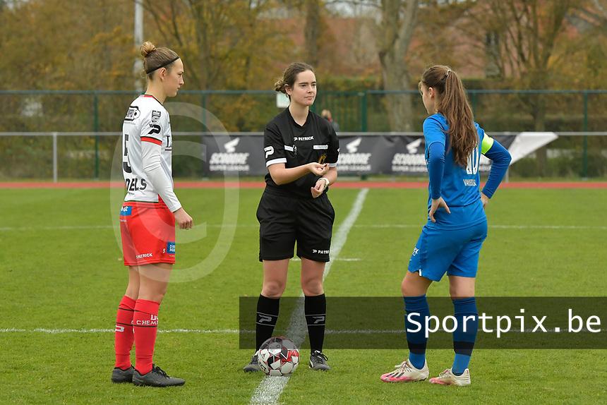 Referee Irmgard Van Meirvenne (M) with Zulte Waregem's defender Pauline Windels (L) and Genk's midfielder Sien Vandersanden (R)  pictured during a female soccer game between SV Zulte - Waregem and KRC Genk on the 8 th matchday of the 2020 - 2021 season of Belgian Scooore Women s SuperLeague , saturday 21 th of November 2020  in Zulte , Belgium . PHOTO SPORTPIX.BE | SPP | DIRK VUYLSTEKE