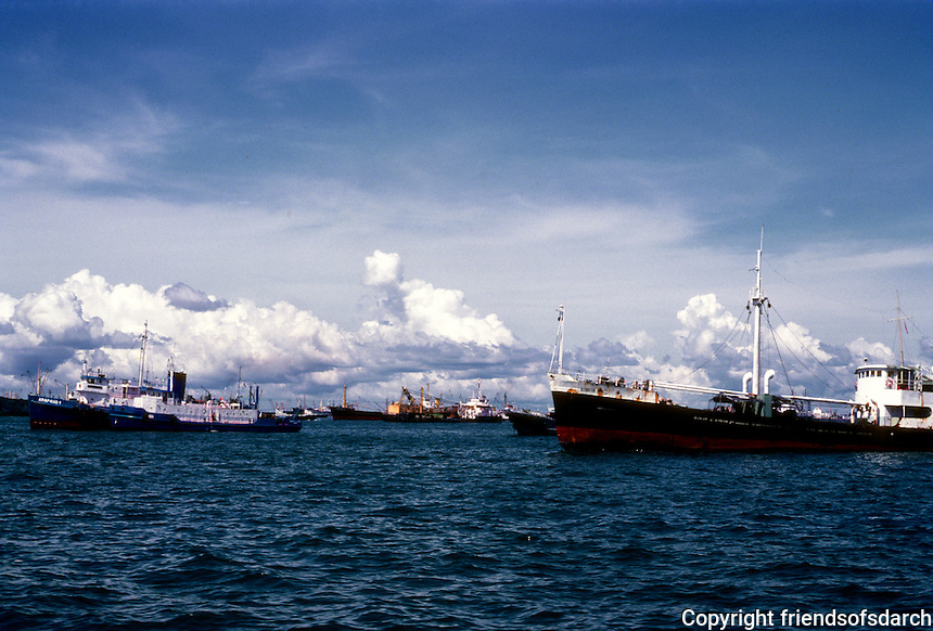 Singapore: Ships in the roadsted at anchor. Magnificent clouds. Photo '83.