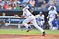 Asheville Tourists Cristopher Navarro (11) runs to first base during a game against the Rome Braves at McCormick Field on August 12, 2019 in Asheville, North Carolina. The Tourists defeated the Braves 11-6. (Tony Farlow/Four Seam Images)