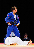 04 DEC 2011 - LONDON, GBR - Sally Conway (GBR) (in blue) looks for a point during the women's -70kg final against Maria Portela (BRA) (in white) at the London International Judo Invitational and 2012 Olympic Games test event at the ExCel Exhibition Centre in London, Great Britain (PHOTO (C) NIGEL FARROW)