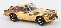 BNPS.co.uk (01202) 558833<br /> Pic: C&TAuctioneers/BNPS<br /> <br /> A rare gold-plated James Bond Aston Martin toy car has sold for £3,500.<br /> <br /> The 3.75ins miniature 261 DB5 sports car was produced by manufacturers Corgi in 1965 to tie-in with the release of the classic 007 film Goldfinger.<br /> <br /> It has a suited figure of Bond at the wheel, a working ejector seat, a rear bullet screen, retractable machine guns and loose bandit figures.