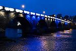 The city of Perth shows it's support for St Johnstone ahead of Saturdays Scottish Cup Final against Hibs at Hampden... 20.05.21<br />Perth Bridge illuminated in blue and white in support of St Johnstone ahead of saturday's Scottish Cup Final against Hibs.<br />Picture by Graeme Hart.<br />Copyright Perthshire Picture Agency<br />Tel: 01738 623350  Mobile: 07990 594431