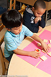 Education preschool 4 year olds two boys playing memory game