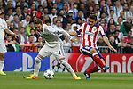 Real Madrid's Sergio Ramos (L) and Atletico del Madrid´s Koke during quarterfinal second leg Champions League soccer match at Santiago Bernabeu stadium in Madrid, Spain. April 22, 2015. (ALTERPHOTOS/Victor Blanco)