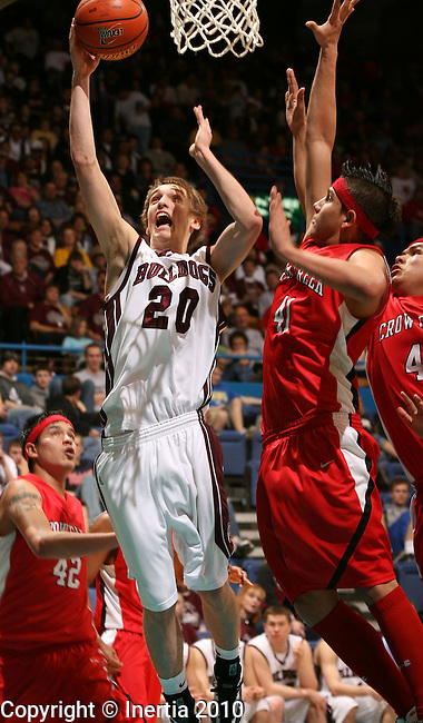 SIOUX FALLS, SD - MARCH 18: Mitch White #20 of Madison shoots over Vilas Fallis, Jr. #41 in the second half of their quarterfinal game Thursday afternoon at the 2010 South Dakota Boys Class A Basketball Tournament at the Sioux Falls Arena in Sioux Falls, SD. (Photo by Dave Eggen/Inertia)