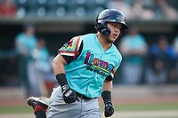 Frainyer Chavez (5) of the Llamas de Hickory hustles down the first base line against the Winston-Salem Rayados at Truist Stadium on July 6, 2021 in Winston-Salem, North Carolina. (Brian Westerholt/Four Seam Images)