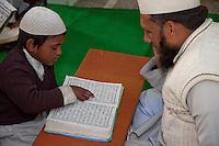 Madrasa Student Reading the Koran for his Imam, Madrasa Imdadul Uloom, Dehradun, India.