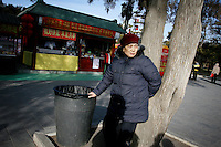 CHINA. An old woman during Chinese New Year in Ditan Park in Beijing.  Chinese New Year, or Spring Festival, is the most important festival and holiday in the Chinese calendar In mainland China, many people use this holiday to visit family and friends and also visit local temples to offer prayers to their ancestors. The roots of Chinese New Year lie in combined influences from Buddhism, Taoism, Confucianism, and folk religions.  2008.