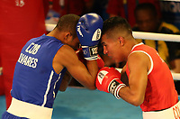 BARRANQUILLA - COLOMBIA, 25-07-2018: PAREDES ROMERO Albeiro J. (Colombia) vs ALVAREZ ESTRADA Lazaro J. (Cuba) durante su participación en boxeo masculino categoría ligero (60kg) como parte de los Juegos Centroamericanos y del Caribe Barranquilla 2018. /  PAREDES ROMERO Albeiro J. (Colombia) vs ALVAREZ ESTRADA Lazaro J. (Cuba) during their participation in the boxing men's light (60kg) category of the Central American and Caribbean Sports Games Barranquilla 2018. Photo: VizzorImage / Cont