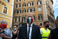 "Rome, 16/07/2020. Today, people gathered in Piazza Montecitorio, outside the Chamber of Deputies of the Italian Parliament, to protest against the so called Zan Bill Against Homotransphobia and Misogyny (1.) (DDL Zan contro l'omotransfobia e la misoginia): ""Amendments to articles 604-bis and 604-ter of the penal code, on violence or discrimination on grounds of sexual orientation or gender identity"" (569) (Proposta di legge: ZAN: ""Modifiche agli articoli 604-bis e 604-ter del codice penale, in materia di violenza o discriminazione per motivi di orientamento sessuale o identità di genere"" [569]), proposed by Democratic Party (PD) Alessandro Zan MP. From the protesters press release (2.): «Some would like a criminal law against homophobia and transphobia, and several bills have been made in Parliament. But homosexual and transsexual people are already rightly protected by law against violent, insulting or discriminatory acts, like any other citizen. So what is a law against homotransphobia for? In fact, this law hides serious dangers. Punishing people on the basis of ambiguous and imprecise crimes of ""instigation to homophobic or transphobic discrimination"" represents a threat to the freedom of thought, religion and association of all citizens. The politicians who propose these laws often indicate as ""homophobic"" those who disagree with them on issues such as family, sexuality, children's rights. To claim that children have the right to grow up with a mom and dad would be homophobic, publicly expressing their opposition to the rented womb or gay adoptions would be homophobic; reading publicly some passages of Saint Paul the Apostle would be homophobic; to say that the sexes are two male and female and are not fluid would be transphobic […]».<br />