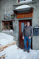 'Lulu', Lucian Blanc, producer of goats cheese, poses for the photographer in front of the door to his home & cheese shop, Bonneval sur Arc, Savoie, France, 16 February 2012.