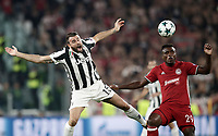 Football Soccer: UEFA Champions League Juventus vs Olympiacos Allianz Stadium. Turin, Italy, September 27, 2017. <br /> Olympicos' Emmanuel Emenike (r) in action with Juventus' Andrea Barzagli (l) during the Uefa Champions League football soccer match between Juventus and Olympiacos at Allianz Stadium in Turin, September 27, 2017.<br /> UPDATE IMAGES PRESS/Isabella Bonotto