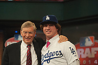 Pitcher Grant Holmes (Conway H.S. (SC)) the number 22 overall pick to the Los Angeles Dodgers with Commissioner Bud Selig during the MLB Draft on Thursday June 05,2014 at Studio 42 in Secaucus, NJ.   (AP Photo/Tomasso DeRosa)