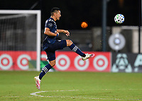 LAKE BUENA VISTA, FL - JULY 26: Roger Espinoza of Sporting KC plays the ball out of the air during a game between Vancouver Whitecaps and Sporting Kansas City at ESPN Wide World of Sports on July 26, 2020 in Lake Buena Vista, Florida.