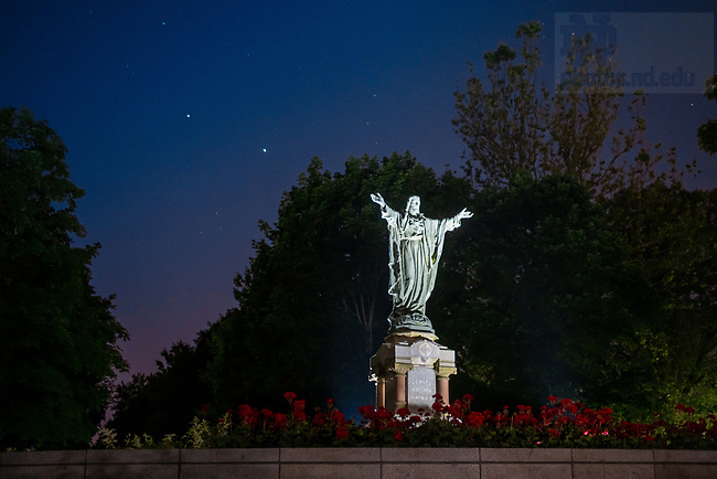 June 18, 2020; Sacred Heart Jesus statue on Main Quad, two bright lights in the sky are Saturn, left, and Jupiter (Photo by Matt Cashore/University of Notre Dame)