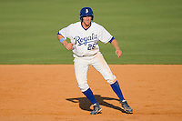 Geoff Baldwin #26 of the Burlington Royals takes his lead off of first base against the Kernersville Bulldogs in an exhibition game at Burlington Athletic Stadium June20, 2010, in Burlington, North Carolina.  Photo by Brian Westerholt / Four Seam Images