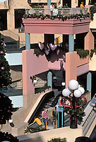 Horton Plaza:  Colorful walls and stairways, decorative lighting, festive mood.  Photo Jan. 1987.