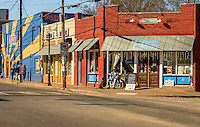 NoDa Neighborhood<br /> <br /> NoDa- Charlotte Historic Arts District, located in North Charlotte neighborhood in the North Davidson and 36th Street.<br /> <br /> NoDa resident Scott McCune and Louise Bhavneni and their dog Gus, enjoy the early morning sunshine on NoDa's main street, as they enjoy their morning coffee.<br /> <br /> Charlotte Photographer - PatrickSchneiderPhoto.com