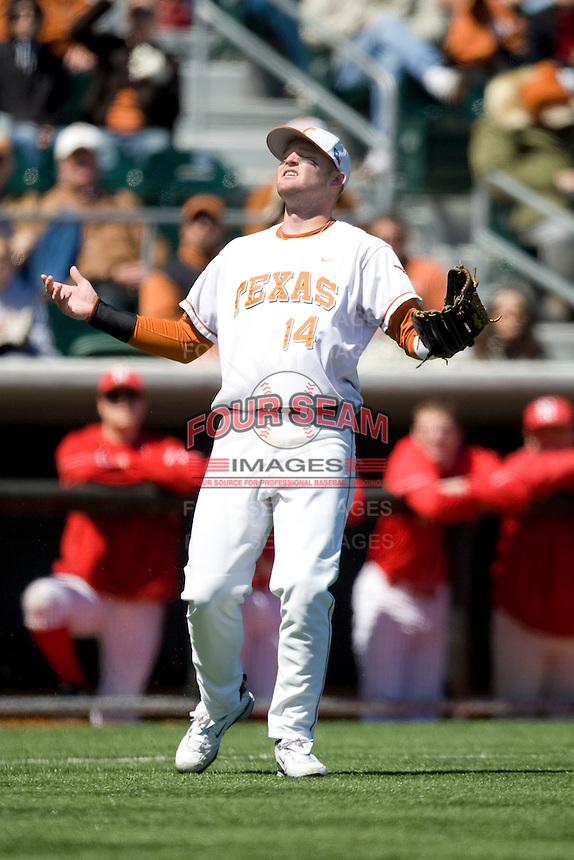 Texas Longhorn 3B Kevin Lusson loses the ball in the sun against Nebraska on Sunday March 21st, 2100 at UFCU Dish-Falk Field in Austin, Texas.  (Photo by Andrew Woolley / Four Seam Images)